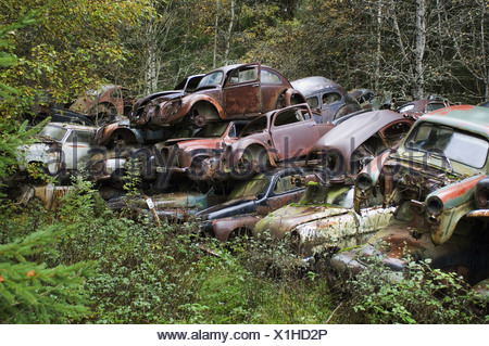 Pile of scrap cars in forest, Sweden - Stock Photo