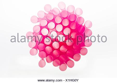 Studio shot of pink drinking straws