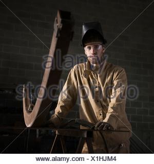 USA, Utah, Orem, portrait of male welder in workshop - Stock Photo