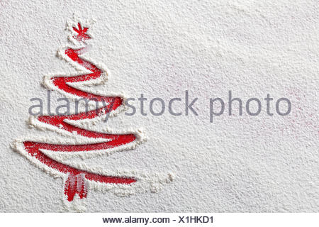 Christmas tree on flour background. White flour looks like snow. Top view - Stock Photo