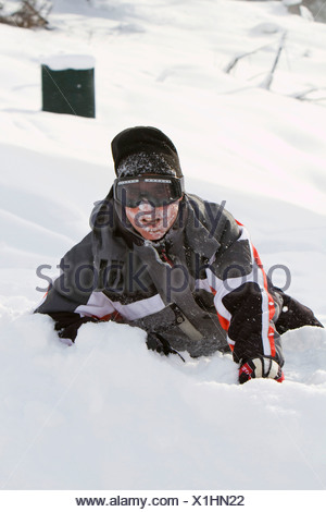 Skier, without a helmet, after a fall - Stock Photo