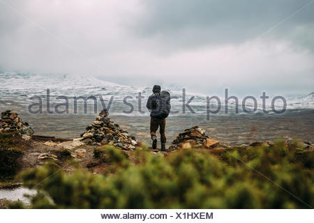 Sweden, Sylama, Jamtland, Man hiking in mountains - Stock Photo