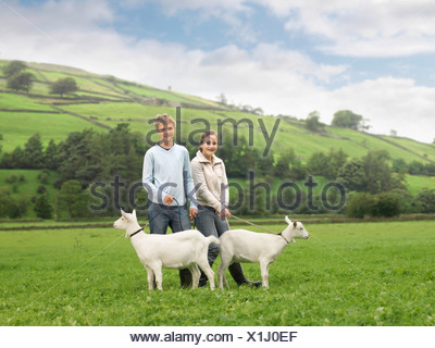 Boy And Girl with Goats - Stock Photo