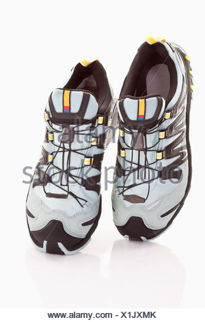Close up of running shoes on white background - Stock Photo