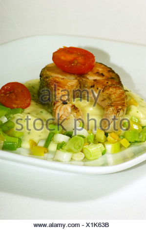 grilled salmon fillet on mashed potato and spring onion - Stock Photo