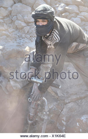 young man mining lead sulfide , Morocco - Stock Photo