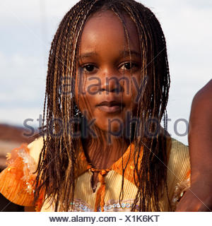 young girl with breaded hair, Rwanda, Nyamirambo, Kigali - Stock Photo