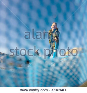 Boy using a crabbing net - Stock Photo