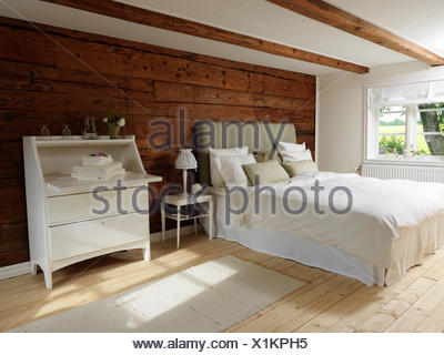 Sweden, Scandinavian style bedroom with wood and white color theme - Stock Photo