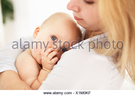 Mother holding baby girl - Stock Photo