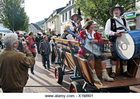 musicians on trailer at Oktoberfest, Germany, North Rhine-Westphalia, Ruhr Area, Witten - Stock Photo