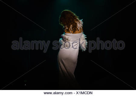 Rear view of clothed stripper, Oakland, California, USA - Stock Photo