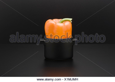 Yellow bell pepper in miniature pot - Stock Photo