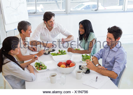 Business people eating lunch together - Stock Photo
