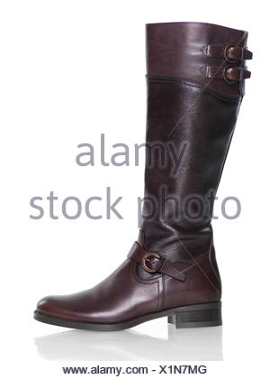 Knee-high brown leather lady's boot - Stock Photo