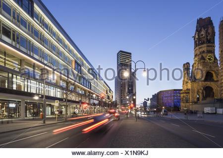 Bikini Shopping Center and Kaiser Wilhelm Memorial Church, Waldorf Astoria Hotel, Berlin, Germany - Stock Photo
