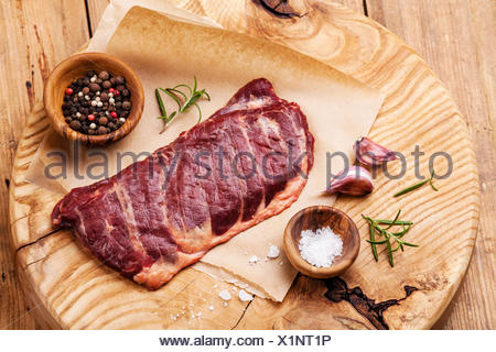 Raw fresh meat Steak Machete with salt and pepper on wooden background - Stock Photo