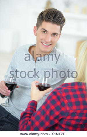 Young man having a drink with a woman - Stock Photo