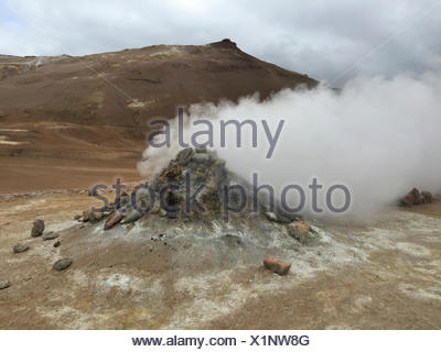 Steaming vents,craters,fissures and lava floes near Krafla volcano,a geothermal area at the northern side of the Lake Myvatn in northern Iceland. - Stock Photo