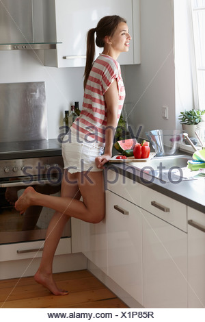 Woman looking out of window - Stock Photo