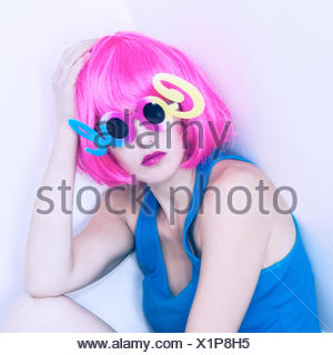 Portrait of a Woman in pink wig and cool sunglasses - Stock Photo