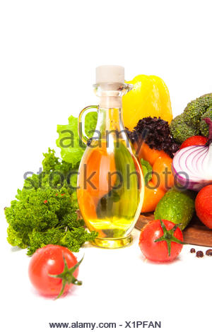 oil in a vessel with vegetables - Stock Photo