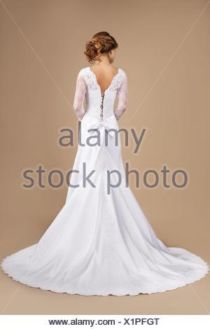 Holiday. Rear View of Auburn Woman in Long Festive Dress - Stock Photo