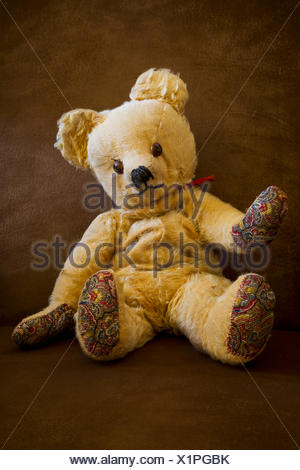 Well loved and worn teddy bear; Vancouver, British Columbia, Canada - Stock Photo