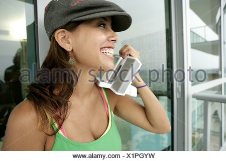 View of a woman holding a device. - Stock Photo