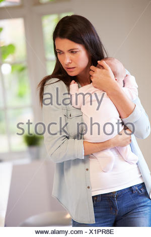 Mother With Baby Suffering From Post Natal Depression - Stock Photo