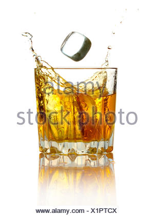 Splash in glass of whiskey and ice isolated - Stock Photo