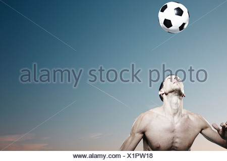 Man in park with football - Stock Photo