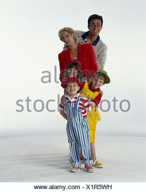 Family, happy, group picture parents, young, children, three, smile, stand, happy, one after the other, boys, girls, sons, subsidiary, three, 'organ pipes', siblings, studio, cut out, - Stock Photo