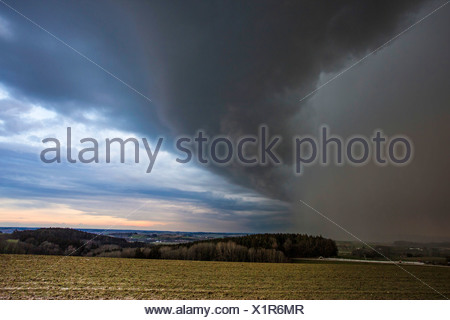 dramatical storm front with heavy rain tracking over river valley, Germany, Bavaria, Isental Stock Photo