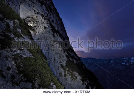 The entrance of Eisriesenwelt Eishoehle with the Austrian Alps in the distance. - Stock Photo