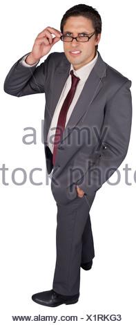 Thinking businessman touching his glasses - Stock Photo