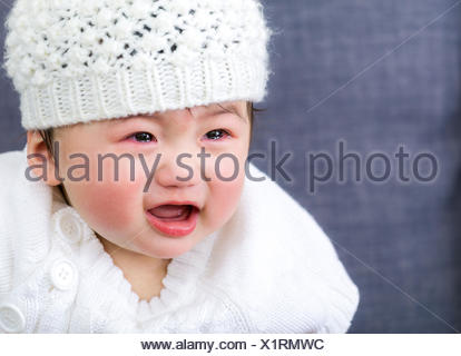 Asian baby girl crying - Stock Photo