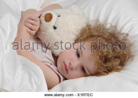 Sick girl lying in bed stock vector art illustration vector image sick girl lying in bed with teddy bear stock photo thecheapjerseys Choice Image