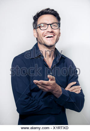 Portrait of mature man wearing glasses - Stock Photo