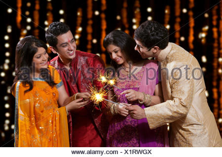 Friends playing with firecrackers - Stock Photo