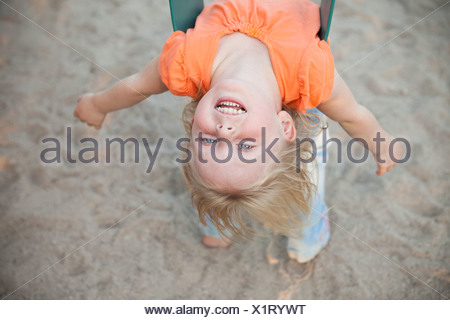 Female Upside Down With Long Curly Brunette Hair Hanging