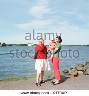 Finland, Helsinki, Uusimaa, Portrait of mother, daughter (2-3) and grandmother - Stock Photo