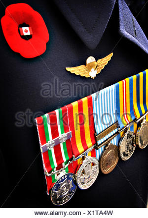 Veteran uniform on Rememberance Day with medals and rememberance day poppy, Canada - Stock Photo