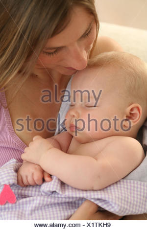 Nut, baby, 4 months, sleep, smile Indoor, girls, people, woman, suture, touch, portrait, curled, happily, hold tenderness, security, motherly love, arm, - Stock Photo