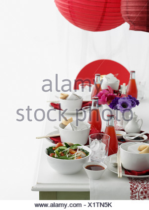 Table set with Chinese food and soda - Stock Photo