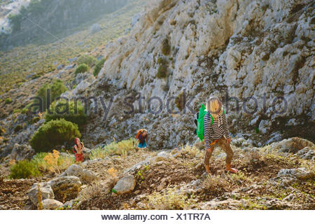 Greece, Dodecanese, Kalymnos, Young woman exploring mountains - Stock Photo