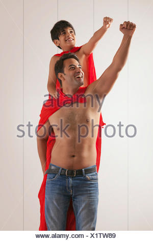 Father and son acting as super heroes - Stock Photo