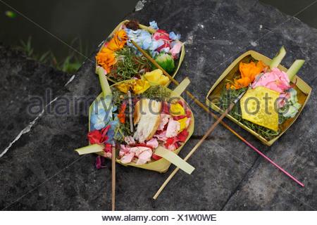 Sacrifical offerings to the gods, near Ubud, Indonesia - Stock Photo