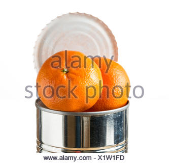 Oranges bursting out of tin can - Stock Photo