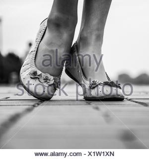 Low Section View Of Woman Wearing Sandals - Stock Photo